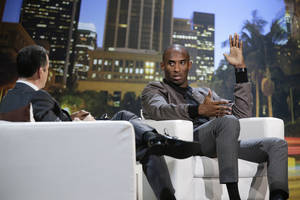 Photo - Los Angeles Lakers' Kobe Bryant, right, talks to talk show host Jimmy Kimmel during a one-on-one conversation at Nokia Theatre on Thursday, Aug. 15, 2013, in Los Angeles. The event was held to raise money toward eliminating homelessness in the Los Angeles area. (AP Photo/Jae C. Hong)
