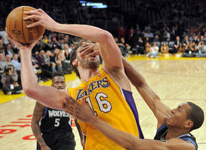 Photo - Minnesota Timberwolves guard Wesley Johnson, right, fouls Los Angeles Lakers forward Pau Gasol of Spain during the second half of their NBA basketball game, Wednesday, Feb. 29, 2012, in Los Angeles. The Lakers won 104-85.  (AP Photo/Mark J. Terrill)  ORG XMIT: LAS108