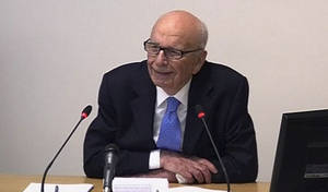 Photo -   In this image from video, News Corp. chairman Rupert Murdoch appears at Lord Justice Brian Leveson's inquiry in London, Wednesday April 25, 2012 to answer questions under oath about how much he knew about phone hacking at the News of the World tabloid. Murdoch is being grilled on his relationship with British politicians at the country's media ethics inquiry, while a government minister is battling accusations he gave News Corp. privileged access in its bid to take over a major broadcaster. (AP Photo/Pool)