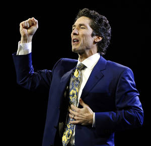 "photo - Joel Osteen, well known televangelist and pastor of Lakewood Church in Houston, Texas, brings his ""A Night of Hope"" tour to the Chesapeake Energy Arena on Friday, Sept. 28, 2012 in Oklahoma City, Okla.  Photo by Steve Sisney, The Oklahoman"