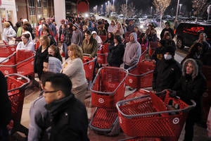photo -   FILE- In this Friday, Nov. 25, 2011, file photo, a crowd of shoppers wait outside the Target store in Lisbon, Conn., before the store opens for Black Friday shopping at midnight. Stores are making a big push to lure in bargain-hungry shoppers before the Friday after Thanksgiving, the traditional start of the holiday shopping season. They are putting on special sales that further creep into Turkey Day, and earlier. (AP Photo/The Day, Sean D. Elliot, File)