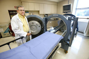 photo - Dr. William Truels with the hyperbaric chamber at Deaconess Wound Care and Hyperbarics located at Deaconess at Bethany in Bethany Wednesday, Oct. 10, 2012.  Photo by Paul B. Southerland, The Oklahoman