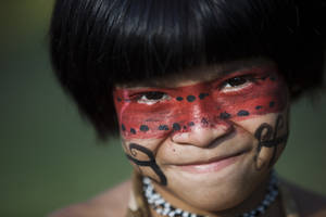 photo -   A boy of the Guarani Kaiowa tribe poses for a photo at the Kari-Oca village, where indigenous from around the world are staying during the United Nations Conference on Sustainable Development, or Rio+20, in Rio de Janeiro, Brazil, Wednesday, June 13, 2012. The Rio+20 conference is expected to draw some 50,000 participants including delegates, environmental activists, business leaders and indigenous groups. The event runs through June 22, with three final days of high-profile talks among some 130 top leaders from nations around the globe. (AP Photo/Felipe Dana)