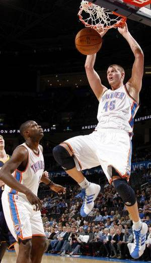 Photo - Oklahoma City's Cole Aldrich (45) dunks the ball beside Nazr Mohammed (8) during the NBA basketball game between the Oklahoma City Thunder and the Indiana Pacers at the Oklahoma City Arena, Wednesday, March 2, 2011. Photo by Bryan Terry, The Oklahoman <strong>BRYAN TERRY</strong>