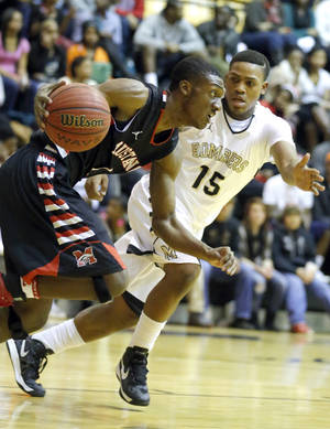 Photo - HIGH SCHOOL BASKETBALL TOURNAMENT: Mustang's Jakolby Long tries to get by Midwest City's Cornell Neal during the boys basketball game between Mustang and Midwest City at the Midwest City/Del City Holiday Invitational,  Saturday,Dec. 29, 2012. Photo by Sarah Phipps, The Oklahoman