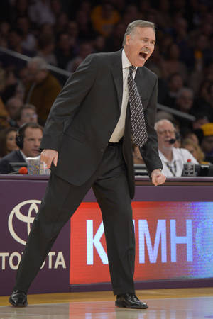 Photo - Los Angeles Lakers coach Mike D'Antoni yells to his team during the first half of their NBA basketball game against the Utah Jazz, Sunday, Dec. 9, 2012, in Los Angeles. (AP Photo/Mark J. Terrill)