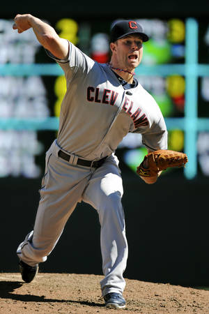 Photo -   Cleveland Indians pitcher Corey Kluber throws against the Minnesota Twins in the third inning of their baseball game in Minneapolis, Sunday, Sept. 9, 2012. (AP Photo/Craig Lassig)