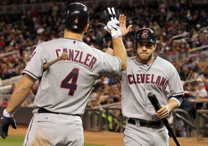 Photo -   Cleveland Indians' Jason Kipnis, right, is congratulated by teammate Russ Canzler (4) after scoring the go-ahead run on Michael Brantley's RBI-single against Minnesota Twins relief pitcher Alex Burnett during the seventh inning of a baseball game on Friday, Sept. 7, 2012, in Minneapolis. (AP Photo/Genevieve Ross)