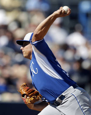 Photo - Kansas City Royals starting pitcher Jason Vargas throws during the fourth inning of a spring exhibition baseball game against the San Diego Padres, Sunday, March 16, 2014, in Peoria, Ariz. (AP Photo/Darron Cummings)