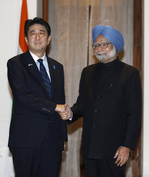 Photo - Japanese Prime Minister Shinzo Abe, left, poses with Indian Prime Minister Manmohan Singh for photographers before a meeting in New Delhi, India, Saturday, Jan. 25, 2014. Abe arrived Saturday on a three-day official visit to India and will also be the Chief Guest on India's Republic Day parade, celebrated on Jan. 26. (AP Photo/Saurabh Das)