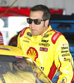 photo -   Sam Hornish Jr. climbs into his race car during practice for Sunday's NASCAR Sprint Cup Series Pennsylvania 400 auto race, Friday, Aug. 3, 2012, at Pocono Raceway in Long Pond, Pa. Hornish has replaced A.J. Allmendinger while NASCAR is still investigating Allmendinger's positive drug test. (AP Photo/Mel Evans)