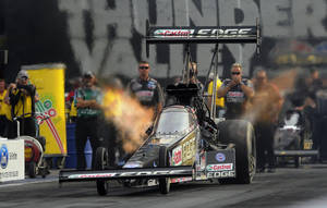 Photo - In this photo provided by NHRA, Top Fuel driver Brittany Force races to the qualifying lead Friday at the Ford NHRA Thunder Valley Nationals at Bristol Dragway. Force led the category with a performance of 3.828 seconds at 317.94 mph at the NHRA Mello Yello Drag Racing Series event. If the time holds through Saturday's qualifying, it will be her second No. 1 qualifying position of the season. (AP Photo/NHRA,Teresa Long)