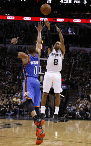 Photo - San Antonio's Patty Mills (8) shoots as Oklahoma City's Russell Westbrook (0) defends during Game 1 of the Western Conference Finals in the NBA playoffs between the Oklahoma City Thunder and the San Antonio Spurs at the AT&T Center in San Antonio, Monday, May 19, 2014. Photo by Sarah Phipps, The Oklahoman