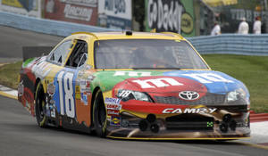 photo -   Kyle Busch drives through the esses during practice for the NASCAR Sprint Cup Series race at Watkins Glen International in Watkins Glen, N.Y., Saturday, Aug. 11, 2012. (AP Photo/David Duprey)