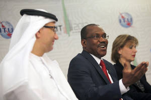 photo - Hamdoun Toure, Secretary General of International Telecommunication Union, ITU, middle, speaks to journalists on the final day of the World Conference on International Telecommunications in Dubai, United Arab Emirates, Friday Dec. 14, 2012. Envoys in Dubai signed a new U.N. telecommunications treaty Friday that a U.S.-led delegation says endorses greater government control of the Internet. The U.S. and more than 20 other countries refused to ratify the accord by the 193-nation International Telecommunications Union.(AP Photo/Kamran Jebreili)