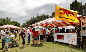 Photo -  Crowds wait in lines to sample Cajun foods at Yukon's Chisholm Trail Crawfish Festival. Photo by Jim Beckel, The Oklahoman  <strong>Jim Beckel -   </strong>