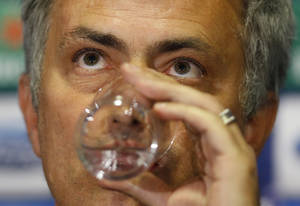 Photo - Chelsea's manager Jose Mourinho takes a drink during a press conference at Stamford Bridge stadium in London, Tuesday, April 29, 2014. Chelsea will play in a Champions League semifinal second leg soccer match against Atletico Madrid on Wednesday. (AP Photo/Kirsty Wigglesworth)