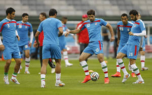 Photo - Iran's Karim Ansarifard, third from right, plays the ball during an official training session the day before the group F World Cup soccer match between Iran and Nigeria at the Arena da Baixada in Curitiba, Brazil, Sunday, June 15, 2014.  (AP Photo/Frank Augstein)