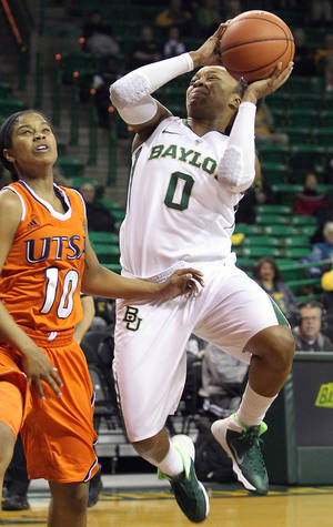 Photo - Baylor's Odyssey Sims (0) is fouled by Texas San Antonio's Kamera King (10) in the first half of an NCAA college basketball game Saturday Nov. 23, 2013, in Waco, Texas. (AP Photo/Waco Tribune Herald, Jerry Larson)