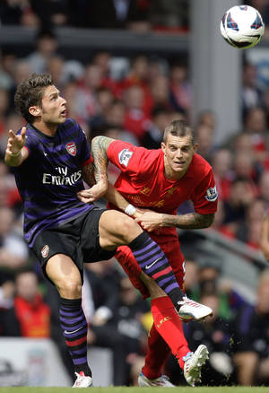 photo -   Liverpool's Daniel Agger, right, fights for the ball against Arsenal's Olivier Giroud during their English Premier League soccer match at Anfield Stadium, Liverpool, England, Sunday, Sept. 2, 2012. (AP Photo/Jon Super)