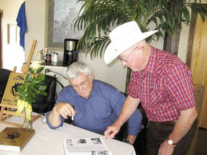 "Photo - From left, Dale Jones, editor of the new historical book ""The Chronicles of Bradley, Oklahoma Thru 1968,"" chats with L.B. Hoyle at his book signing April 13 at the First National Bank in Lindsay. Photo by Brandy McDonnell, The Oklahoman. <strong></strong>"