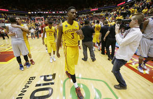 Photo - Iowa State forward Melvin Ejim (3) walks off the court after an NCAA college basketball game against Kansas, Monday, Jan. 13, 2014, in Ames, Iowa. Kansas won 77-70. (AP Photo/Charlie Neibergall)