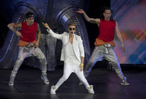 Photo - Canadian singer Justin Bieber performs at the o2 Arena in east London, Monday, March 4, 2013. (Photo by Joel Ryan/Invision/AP)