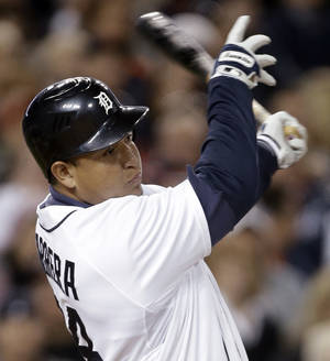 photo -   Detroit Tigers' Miguel Cabrera follows through on a solo home run against the Oakland Athletics in the seventh inning of a baseball game in Detroit, Wednesday, Sept. 19, 2012. (AP Photo/Paul Sancya)