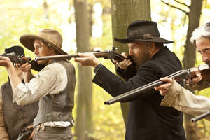 """Photo - From left, Matt Barr and Kevin Costner are shown in a scene from """"Hatfields & McCoys."""" HISTORY PHOTO <strong>Chris Large</strong>"""