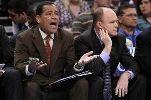 Photo - Milwaukee Bucks assistant coach Kelvin Sampson and head coach Scott Skiles during the Thunder - Bucks game November 27, 2009 in the Ford Center in Oklahoma City. BY HUGH SCOTT, THE OKLAHOMAN
