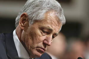 photo - FILE - In this Jan. 31, 2013, file photo  Republican Chuck Hagel, a former two-term GOP senator from Nebraska and President Obama's choice for Defense Secretary, testifies before the Senate Armed Services Committee during his confirmation hearing on Capitol Hill in Washington. A Senate panel on Wednesday, Feb. 6, 2013, abruptly postponed a vote on Chuck Hagel's nomination to be defense secretary amid Republican demands for more information from President Barack Obama's nominee about his paid speeches and business dealings (AP Photo/J. Scott Applewhite, File)