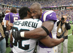 Photo -   Minnesota Vikings running back Adrian Peterson, right, hugs Jacksonville Jaguars running back Maurice Jones-Drew after his team's 26-23 overtime victory in an NFL football game on Sunday, Sept. 9, 2012, in Minneapolis. (AP Photo/Genevieve Ross)