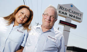 Photo - Co-owner Jim Blakewell and his wife, Laura Blakewell, pose Wednesday for a photo at the Red Carpet Car Wash at 6405 N May, in Oklahoma City. Photo by Nate Billings, The Oklahoman