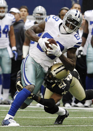 Photo - Dallas Cowboys wide receiver Dez Bryant (88) breaks away from New Orleans Saints cornerback Patrick Robinson (21) to score a touchdown during the first half of an NFL football game on Sunday, Dec. 23, 2012, in Arlington, Texas. (AP Photo/Brandon Wade)