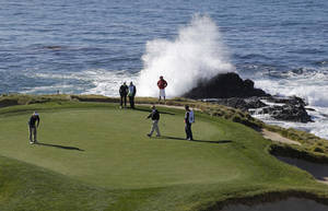 photo - Brandt Snedeker, left, lines up his putt as waves crash behind the seventh green of the Pebble Beach Golf Links during the third round of the AT&T Pebble Beach Pro-Am golf tournament  Saturday, Feb. 9, 2013 in Pebble Beach, Calif. (AP Photo/Eric Risberg)