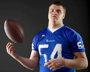 Photo - HIGH SCHOOL FOOTBALL: All-State football player Blake Belcher, of Guthrie, poses for a photo in Oklahoma CIty, Wednesday, Dec. 14, 2011. Photo by Bryan Terry, The Oklahoman