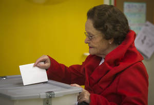 photo -   A voter cast her ballot at a polling station in Ljubljana, Slovenia, Sunday, Nov. 11, 2012. Three candidates are vying for the presidency in Slovenia, a tiny, economically troubled European Union nation that is riven by deep political divisions and is in danger of needing a bailout. (AP Photo/Darko Bandic)