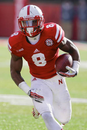 Photo - FILE - This Nov. 29, 2013 file photo shows Nebraska running back Ameer Abdullah with the ball in the second half of an NCAA college football game against Iowa in Lincoln, Neb. Abdullah averaged 130 yards a game and is the nation's top returning rusher. Abdullah and Wisconsin's Melvin Gordon are the nation's top two returning rushers and keys to their teams' bids to win the Big Ten West. (AP Photo/Nati Harnik, File)