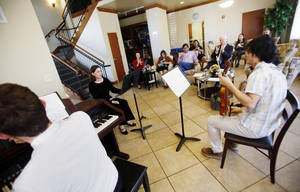 Photo -  Musicians play classical music to entertain guests of the High Tea on the campus of the University of Central Oklahoma. PHOTO BY K.T. KING, FOR THE OKLAHOMAN  <strong>KT King -   </strong>
