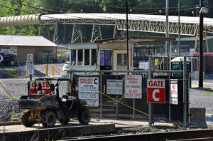 Photo - The entrance to Brody Mine No.1 in Wharton, W.Va., is closed on Tuesday, May 13, 2014. Two workers died after they were trapped as the ground failed at the West Virginia coal mine.  The ground failure occurred just about 8:45 p.m. Monday, trapping the workers, safety agency officials said.  The miners' bodies were recovered, and safety personnel were on the site of Brody Mine No. 1 in Boone County, about 50 miles south of Charleston. Preliminary indications show that a coal burst was responsible, according to state officials and mine owner Patriot Coal. (AP Photo/Charleston Daily Mail, Craig Cunningham )