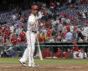 Photo - Washington Nationals' Danny Espinosa talks about the call after striking out swing for the final out of a baseball game against the Cincinnati Reds at Nationals Park on Wednesday, May 21, 2014, in Washington. The Reds won 2-1. (AP Photo/Alex Brandon)