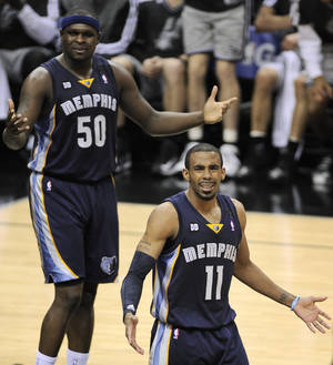 Photo - Memphis Grizzlies' Mike Conley (11) and Zach Randolph react to a call during the second half of Game 1 of the Western Conference final NBA basketball playoff series against the San Antonio Spurs, Sunday, May 19, 2013, in San Antonio. San Antonio won 105-83. (AP Photo/Darren Abate)