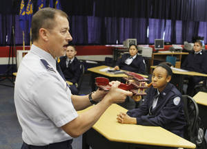 Photo - Air Force Lt. Col. Mike Penning discusses the science of aeronautics during class time for the Midwest City High School JROTC.