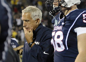 Photo - FILE - In this Sept. 21, 2013 file photo, Connecticut head coach Paul Pasqualoni reacts at the end a 24-21 loss to Michigan in an NCAA college football game at Rentschler Field in East Hartford, Conn. Paqualoni was fired Monday, Sept. 30, 2013, after the Huskies lost the first four games of the season. (AP Photo/Jessica Hill, File)