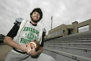 Photo - Gabe Ikard poses for a photo at Bishop McGuinness in Oklahoma City , Okla. December 04, 2008. BY STEVE GOOCH