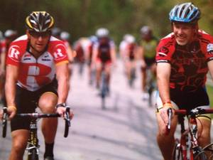 photo - Lance Armstrong and Jerry Burnstein riding together in a Livestrong event. PHOTO PROVIDED <strong></strong>