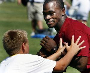 Photo - Adrian Peterson, shown here at his camp in Norman in 2009, will not be able to attend his camp this week. OKLAHOMAN ARCHIVE PHOTO <strong>STEVE SISNEY</strong>