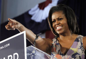 Photo -   First Lady Michelle Obama points to supporters at the War Memorial auditorium Wednesday, Aug. 22, 2012 in Fort Lauderdale, Fla. (AP Photo/Alan Diaz)