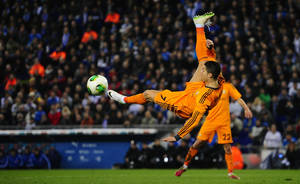 Photo - Real Madrid's Cristiano Ronaldo, from Portugal, kicks the ball against Espanyol during a Copa del Rey soccer match at Cornella-El Prat stadium in Cornella Llobregat , Spain, Tuesday, Jan.21, 2014. (AP Photo/Manu Fernandez)