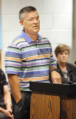 Photo - Robert Romines, incoming superintendent for the Moore Public School district, speaking to reporters during a press conference at Moore High School in Moore. <strong>PAUL B. SOUTHERLAND - PAUL B. SOUTHERLAND</strong>